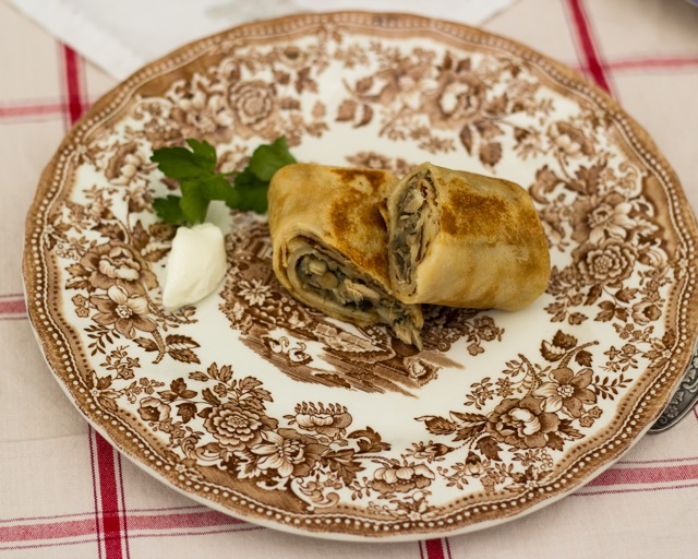 Blini with a chicken and mushroom filling